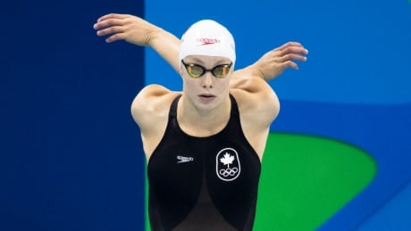 Kevin Light Penny Oleksiak warms up Aug 7 2016 100m butterfly