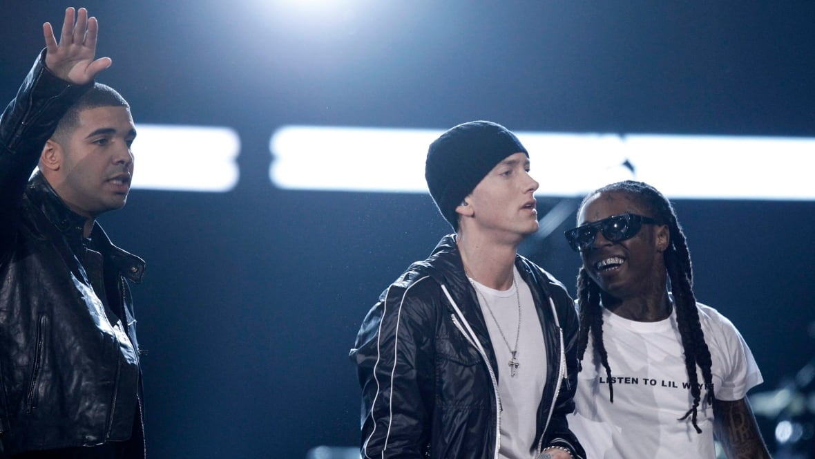 Eminem surprises Drake audience with cameo at Detroit ...