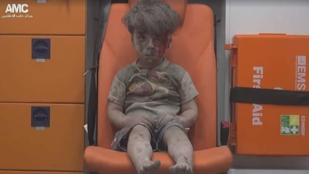 Five-year-old Omran Daqnee was pulled, bloodied and dazed, from the rubble of a hospital in Aleppo, Syria, following an airstrike Wednesday night.