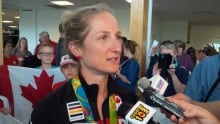 Catharine Pendral answering questions from the media