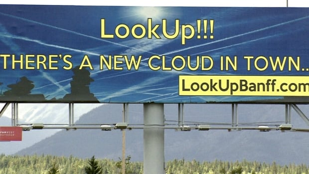 A billboard promoting the 'chemtrails' conspiracy theory stands on the north side of the Trans-Canada Highway between Calgary and Canmore.