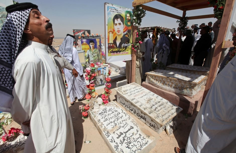 IRAQ CEMETERY Residents visit graves of relatives Peace Valley