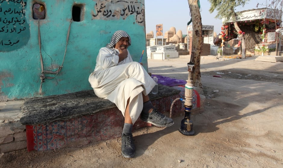 IRAQ Peace Valley CEMETERY undertaker smokes shisha
