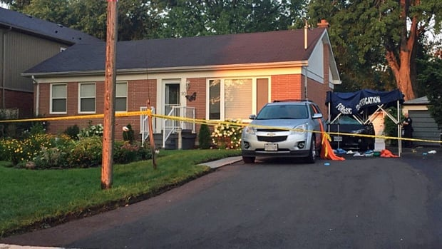 Police took a 35-year-old man into custody Thursday after three people died of wounds police say appear to have been inflicted by a crossbow.