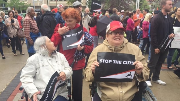 Protesters in Saskatoon rally against provincial cuts to income support programs for people with disabilities.