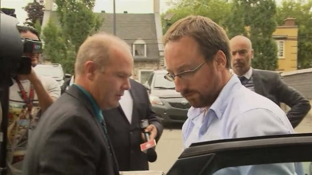 Jonathan Bettez, right, wearing glasses, arrives in court on Tuesday to be formally charged.