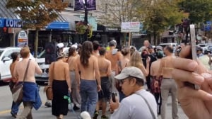 Should Facebook remove nude photos of topless women marching to #freethenipple?