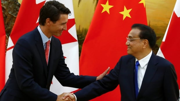 Chinese Premier Li Keqiang, right, shakes hands with Prime Minister Justin Trudeau during the prime minister's visit to China earlier this month. Li will visit Canada Sept. 21 to 24.