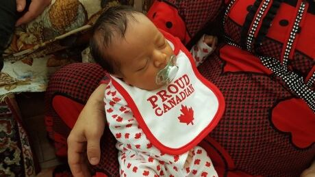 In a maple-leaf onesie, baby Ahmed is a 'proud Canadian' born to Syrian refugee family