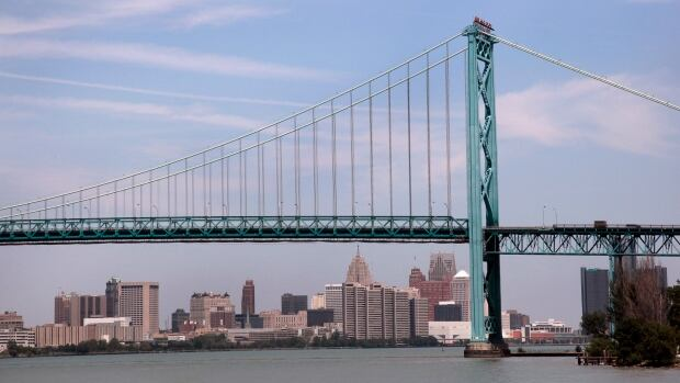 The Detroit city skyline is seen behind the Ambassador Bridge, an international border-crossing linking Windsor, Ont., with Detroit. Transport Canada has ordered the company responsible for the bustling border crossing to make emergency repairs.