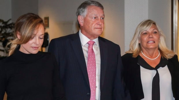 Federal Court Justice Robin Camp arrives with his wife Mariaan, right, and daughter Lauren at a Canadian Judicial Council inquiry in Calgary.