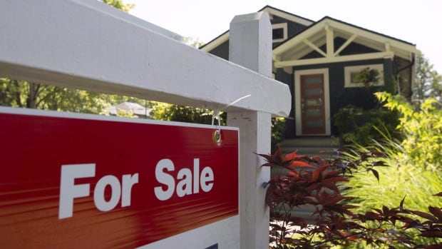 The head of Canada Mortgage and Housing Corp. says high level of debt coupled with high house prices often precede an economic contraction.