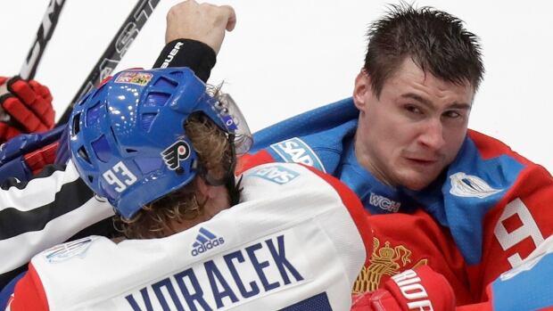 Czech Republic's Jakuk Voracek and Russia's Dmitry Orlov get scrappy during a World Cup tuneup in St. Petersburg