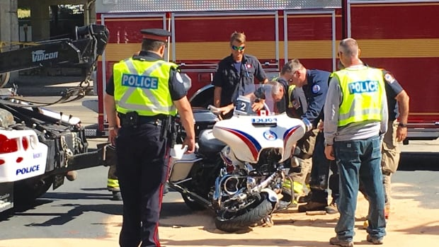 A Toronto police officer on a motorcycle was injured