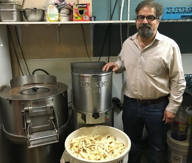 Hamid Sanayie and his french fry cutting machine