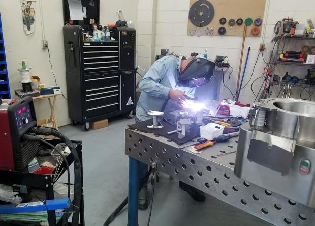 welder works at Hopkins PEI in the West Royalty Industrial Park