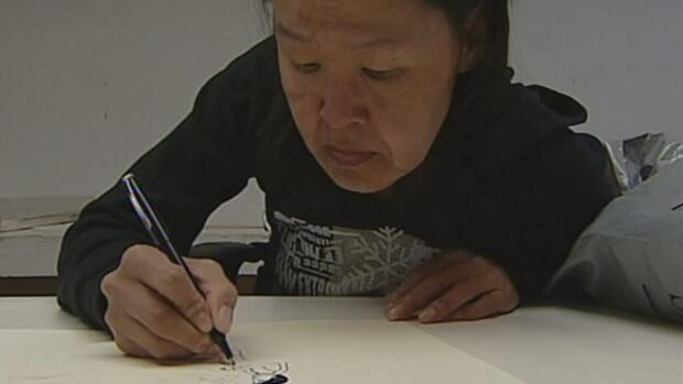 Inuit artist Annie Pootoogook, of Cape Dorset, Nunavut, is seen here in a still from a 2005 documentary. She was found dead on Sept. 19 in Ottawa.