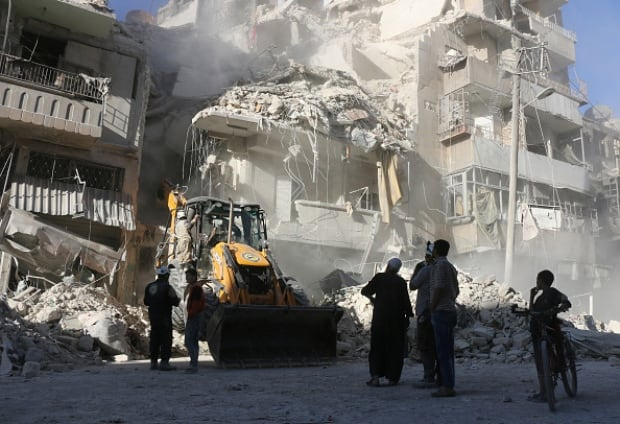 Air strikes pound rebel-held Aleppo districts overnight
