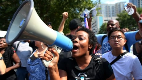 charlotte-protests-stadium-megaphone