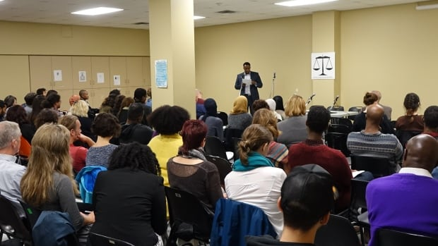 More than 100 people gathered at the Hintonburg Community Centre for a conference that explored issues of race and mental health in the criminal justice system in response to the July death of Somali-Canadian Abdirahman Abdi.