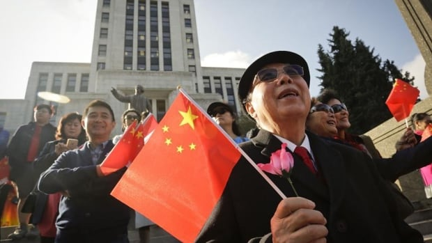 About 300 people turned out to watch the raising of the Chinese national flag outside Vancouver city hall on Friday to celebrate the 67th anniversary of the founding of the People's Republic of China, but the event was only captured by the Chinese government's Xinhua news agency.