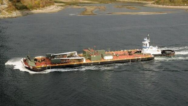 Fuel barge tug leaking diesel after grounding near Bella Bella