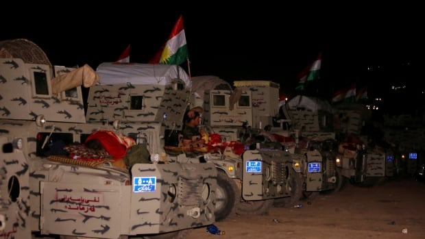 Peshmerga forces gather on the east of Mosul during preparations to attack Mosul, Iraq.