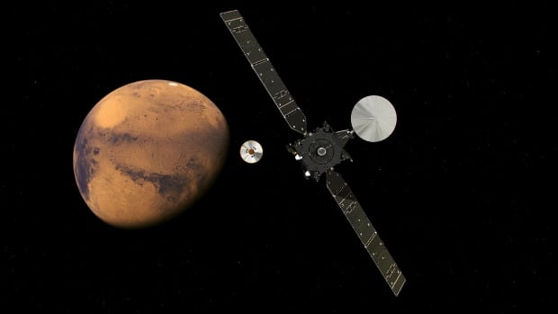 The ExoMars Trace Gas Orbiter and its lander Schiaparelli are pictured in this artist's rendering approaching Mars.
