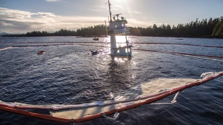 Coast Guard chief defends response to sunken tug in B.C.
