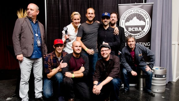Julia Hanlon (back left, holding award) and her team from Steamworks Brewing took home best-in-show at the 2016 B.C. Beer Awards. Hanlon became the first female head brewer to win that distinction.