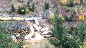 Grain cars tumble into Fraser River as train derails north of Yale, B.C.