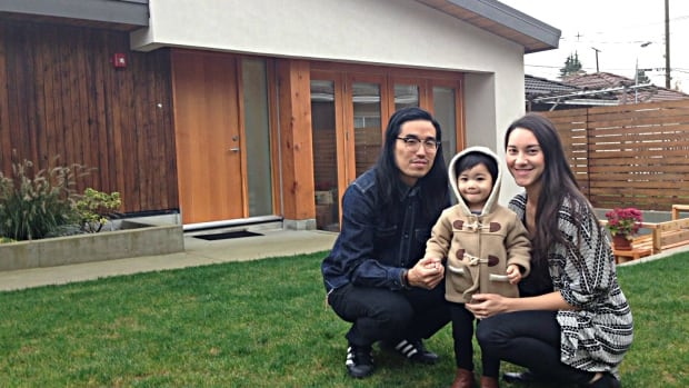 Vincent Chan, Jasmine Lee and their two-year-old daughter, Hazel, in front of their East Vancouver laneway house, which sits on a property owned by Chan's parents. Vancouver and other cities in the Lower Mainland allow property owners to build small houses in their backyards if their homes back onto a laneway.