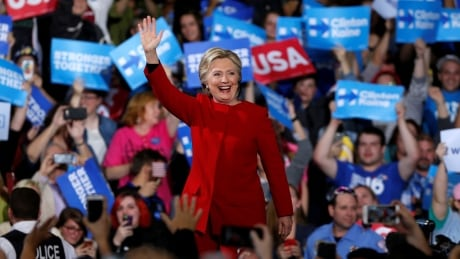 Trump, Clinton campaign until the bitter end as election day begins