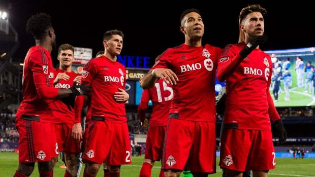 Toronto FC players celebrate their victory against New York City FC on ...