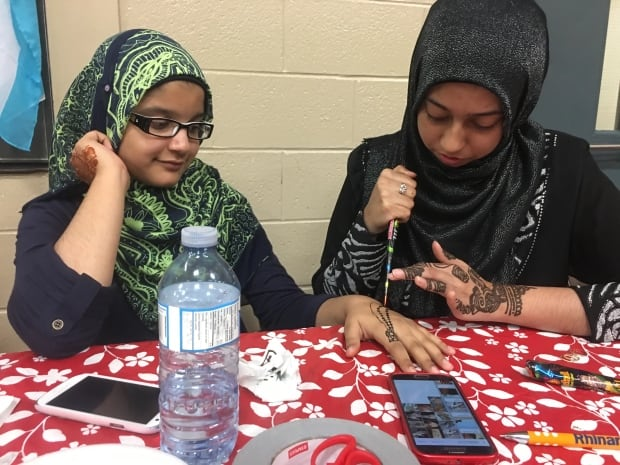 Young girls doing henna