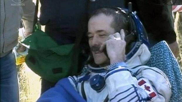 Hadfield returns to Earth