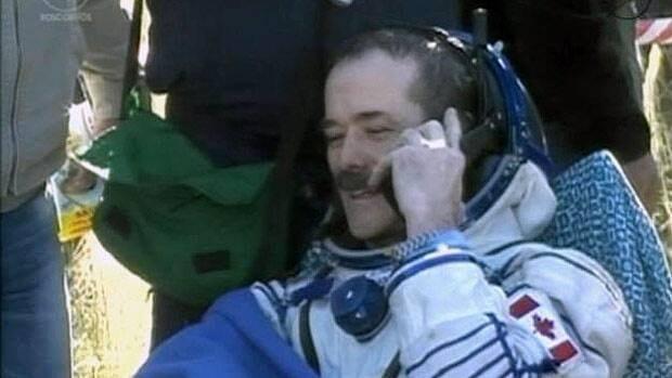 Hadfield returns to Earth