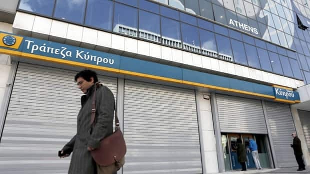 Cyprus trims bank grab