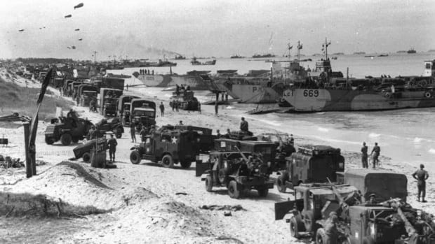 Troops and landing craft occupy a Normandy beach shortly after the D-Day landing. The bombardment of the beaches began at 6 a.m. on June 6, 1944, and within hours soldiers from Canada had established the beachhead at Juno Beach and the German defences were shattered.