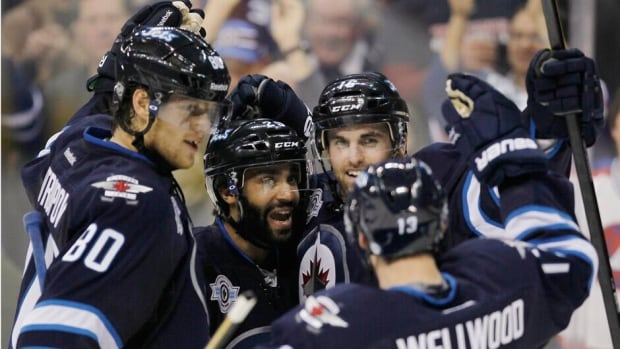 Andrew Ladd, Zach Bogosian, and Blake Wheeler are helping their Winnipeg Jets take over the Southeast Divsion lead.