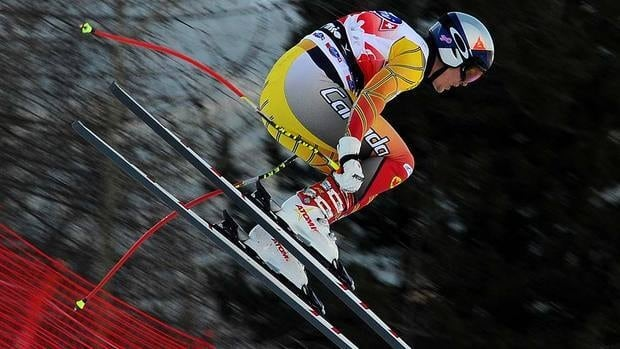 World downhill champion Erik Guay of Canada trailed Dominik Paris by 0.13 to finish in second place on Saturday in Kitzbuehel, Austria.