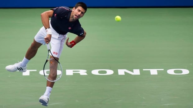 Novak Djokovic hits a return to Fabio Fognini during day 5 of the BNP Paribas Open at Indian Wells Tennis Garden on Sunday in Indian Wells, Calif.