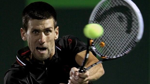 Serbia's Novak Djokovic returns a shot to Germany's Tommy Haas in their fourth round match Tuesday at the Sony Open tennis tournament in Key Biscayne, Fla.