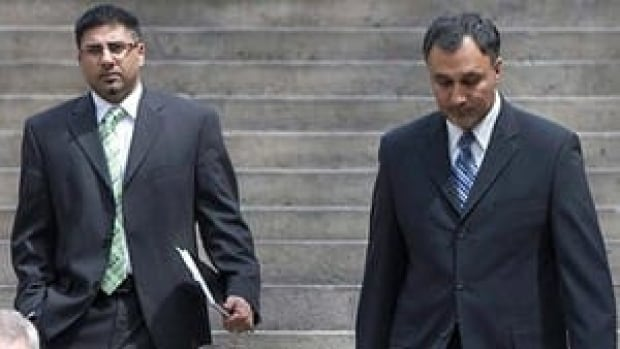 Dave Basi, on the right, and Bobby Virk, on the left, both pleaded guilty in the BC Rail case after the government agreed to pay their $6 million legal bill.