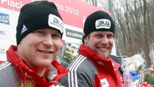 World Cup winners Lyndon Rush, left, and Jesse Lumsden pose after winning the World Cup two-man bobsleigh title on Saturday.