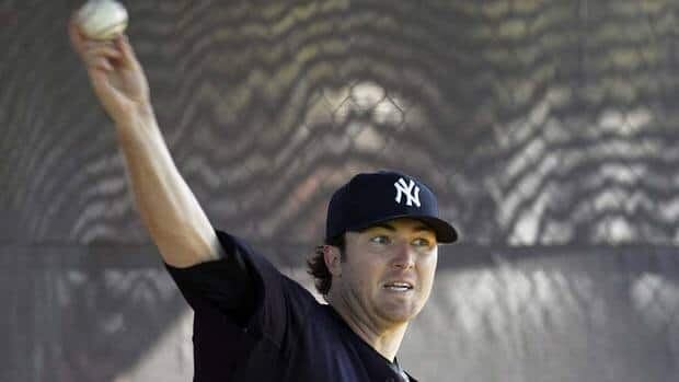 Yankees pitcher Phil Hughes Hughes injured his back Monday during a defensive drill covering first base at spring training and will be sidelined a few days.