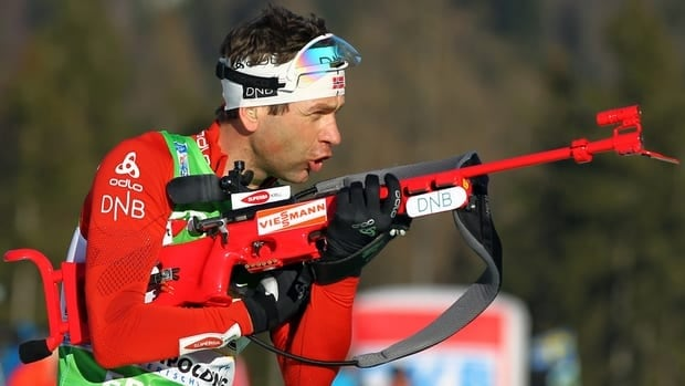 Winner Martin Fourcade of France, foreground right, and second placed Russia's Evgeny Ustyugov compete during the men's 10 km sprint competition at the Biathlon World Cup in Ruhpolding, southern Germany on Saturday.