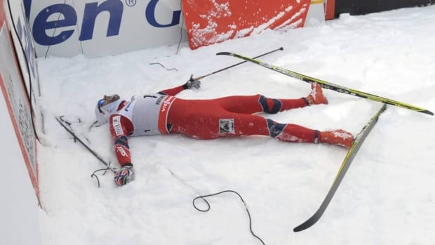 Norway's Petter Northug crosses the finish line, to win his 15-kilometre World Cup event in Lahti, Finland on Sunday.