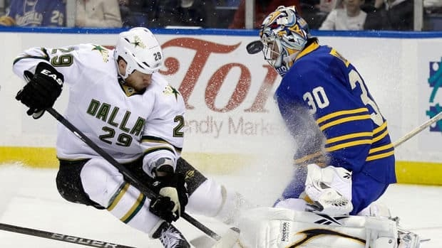 Toronto Maple Leafs forward Joffrey Lupul, right, tries to score past Buffalo Sabres goalie Ryan Miller in Toronto on Monday, January 21, 2013.