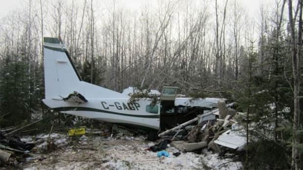 Investigators from the federal Transportation Safety Board took this photograph from the scene of a plane crash in Snow Lake, Man., in November 2012.
